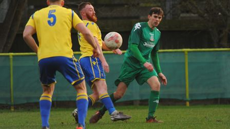Action from Norwich United against Gorleston. Sam Applegate and Sam Watts (5) for Norwich, and Joel