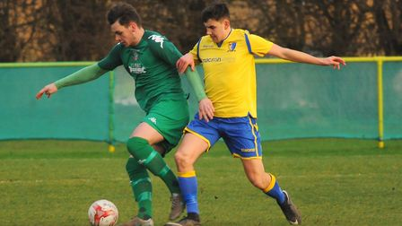 Action from Norwich United against Gorleston. Hadyn Davies for Norwich and Angus Mackie for Gorlesto