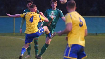 Action from Norwich United against Gorleston. Sam Applegate (4) for Norwich, and Connor Ingram for G