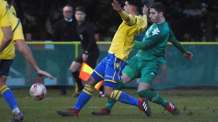 Action from Norwich United against Gorleston. Harry Barker for Norwich, and Dan Camish for Gorleston