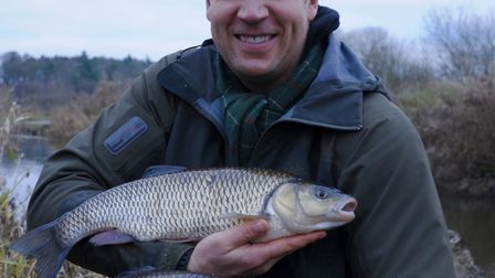 Neill Stephen with two big chub caught on consecutive casts..before moving on Picture: John Bailey