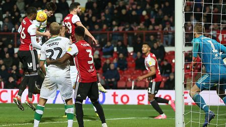 Timm Klose connects with Mario Vrancic's late corner to head Norwich City level at Brentford - altho