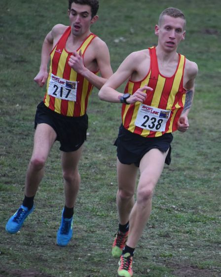 Logan Smith, right, leading the senior men's race at the Norfolk Cross Country Championships in Thet