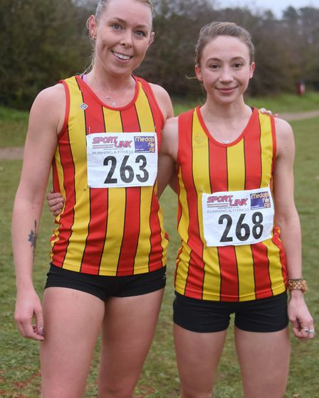 Iona Lake, right, winner, with Dani Nimmock, runner-up, after the senior women's race in the Norfolk