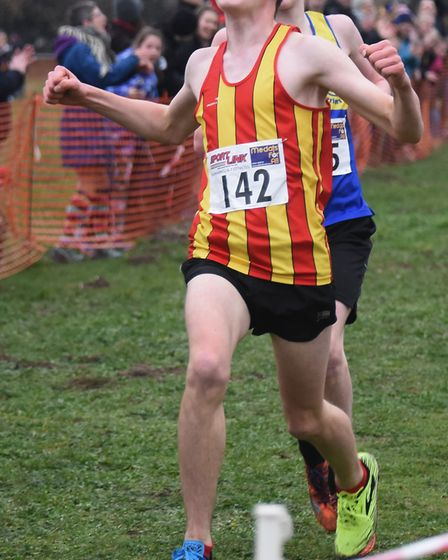 Zak Houghton celebrates finishing third in the U15 boys race at the Norfolk Cross Country Championsh