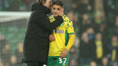 Head coach Daniel Farke has a word in the ear of Max Aarons following the Canaries' victory over Rot