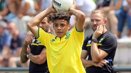 Max Aarons is watched by then Norwich City's then Under-23 coaching team of Darren Huckerby (left) a
