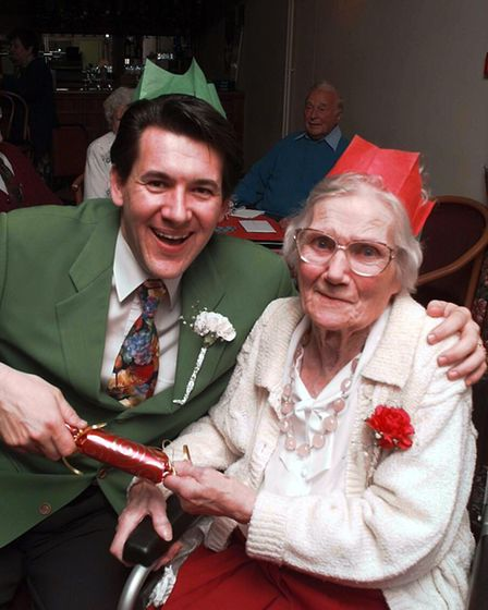 (EDI) Entertainer Olly Day pulls a cracker with 97 year-old Annie Leake at the Tony Boothman Day c