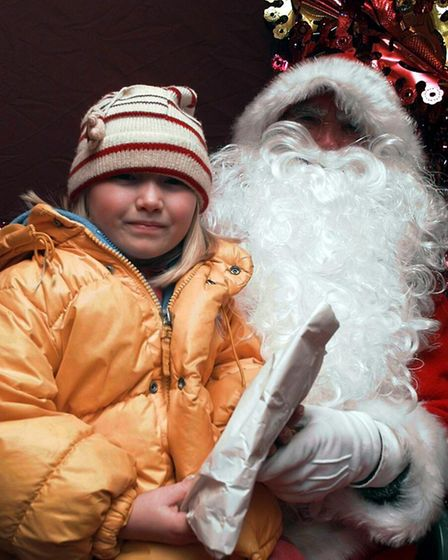 (1/5EDI)Jessica Tomlin (correct), 6, with santa in Dereham for the christmas lights switch on.