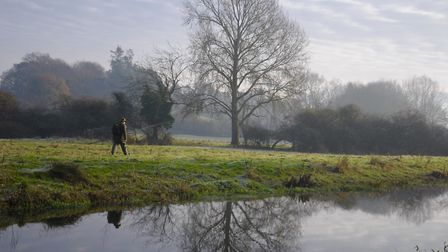Geoff Durham strides to a distant swim on a winter's morning Picture: John Bailey