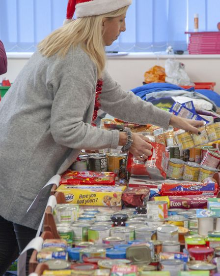 Claire sorting donations from the public. Picture: Nick Stone