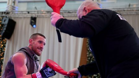 Ryan Walsh and trainer Graham Everett during a public workout in Canary Wharf, ahead of his title fi