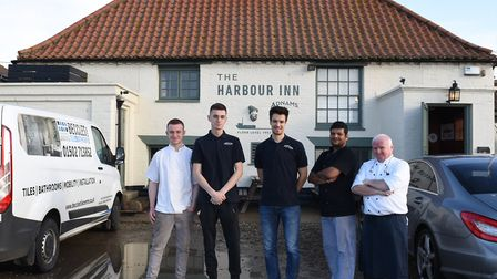 The Harbour Inn is now back to normal after the flooding L-R Jonathan Barnes, George Taylor, Tom Hea