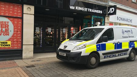 Police Forensics were at the shop on King's Lynn's High Street. Photo: Emily Prince