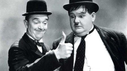 Oliver Hardy looks on amazed as Stan Laurel ignites his thumb Photo: Hal Roach