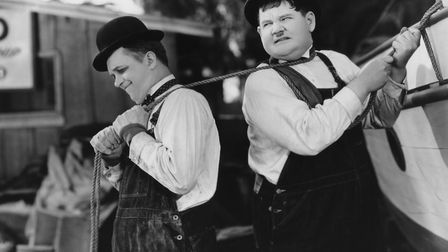 Laurel and Hardy fixing up their boat in their short film Towed In A Hole Photo: Hal Roach