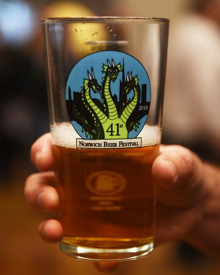 A punter holds a beer at Norwich Beer Festival 2018 at St Andrew's Hall. Picture: ANTONY KELLY