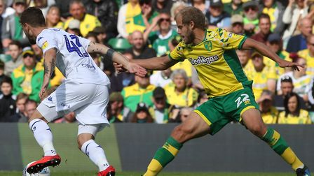 Teemu Pukki tries to get to grips with Leeds' Mateusz Klich during City's defeat at Carrow Road earl