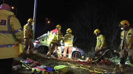 Paramedics and firemen at the scene of the crash on the A47. Photo: Franz Sidney
