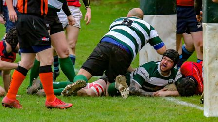 Norwich Union lock Jordan Read looks up to the referee for confirmation after touching down against