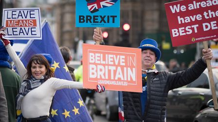 Pro and anti Brexit demonstrators outside the Houses of Parliament in London before Tuesday's common