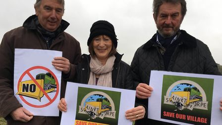 Campaigners with their 'Save Swainsthorpe' posters protest a planning application by local farm equi