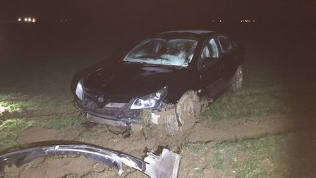 A stolen car that left the road near Acle after a police pursuit from Norwich along the A47.