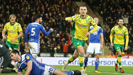 Tom Trybull gets ready to start the celebrations, after his goal effectively sealed Norwich City's v
