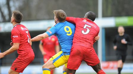 Michael Gash battles with Barwell's Henry Eze during King's Lynn Town's 3-2 win at The Walks Picture