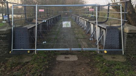 A bridge at Lenwade remains fenced off after it was closed due to health and safety concerns. PIC: P