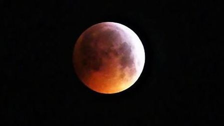 The super blood moon above Lowestoft at 4.45am. Picture: Richard Girling