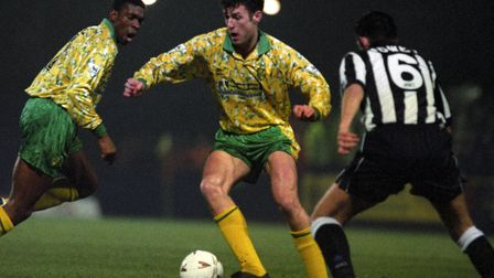 Chris Sutton and, left, Efan Ekoku in action against Newcastle at Carrow Road during the 1993-94 sea