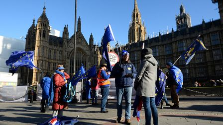 Anti-Brexit campaigners wave European Union flags outside the Houses of Parliament, London. Photo: K