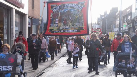 Protesters against the closure of Children's Centres march through Great Yarmouth. Picture: DENISE B