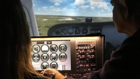 EDP business writer Caroline Culot takes the controls of a simulated Cessna aircraft at Sim-Fly Norf