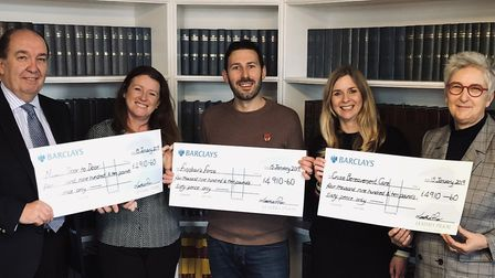 The Leathes Prior team with the cheques which were donated to three different charities after last y