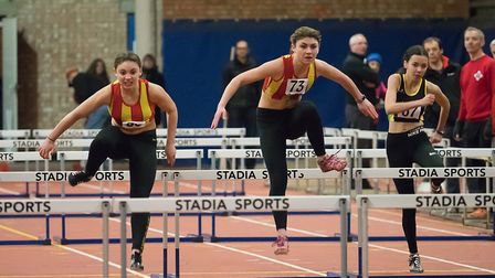 Action from the Under-17 hurdles as Meg Wills and Alisha Youngs go for gold. Picture: Tony Payne