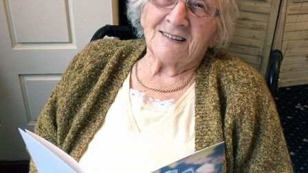 Irene Muttitt poses with a card from the Queen on her 100th birthday. Picture: Adrian Muttitt