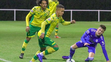 Spencer Keller and Bilal Kamal, behind, in action for Norwich City U23s against Leicester U23s at Co