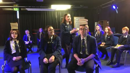 Attleborough Academy students rehearsing The Cursed Child. Balancing scripts on their head as a warm