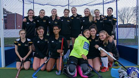 The girls' hockey 1st XI team from Greshams School are celebrating following their success in reachi