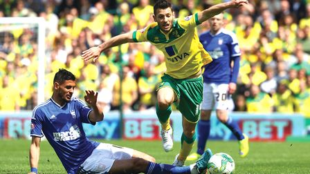 Kévin Bru of Ipswich Town and Wes Hoolahan of Norwich in action during the Sky Bet Championship matc