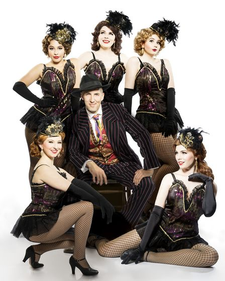 Phil Ormerod as Sky Masterson with the Hotbox dancers in the Norfolk and Norwich Operatic Society's
