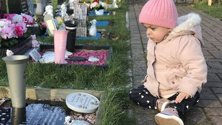 Layla Turner at the grave of her twin sister Angel who was stillborn. Picture: Neil Didsbury