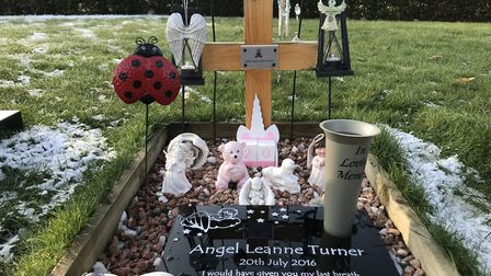 The grave of baby Angel where plastic flowers and holly were removed by the councilPicture: Neil Did