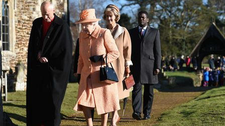 Queen Elizabeth II arrives to attend a Sunday church service at St Peter and St Paul, West Newton, N
