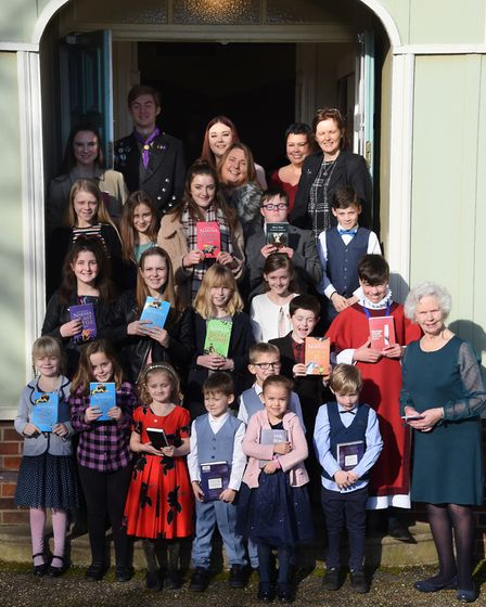 The West Newton Sunday School children with their books presented to them by the Queen. Picture: DEN