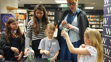 Children learn how to make fun potions with the Waterstones staff at Harry Potter Book Night. Pictur