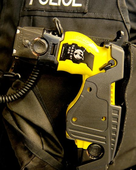 A Police officer armed with a TASER in his body armour.
