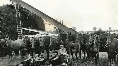 Horses look on as men and boys tuck into their refreshments – an ideal stage for a few helpings of N